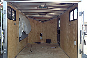Interior view of trailer w/110v, bunk, windows, 12v battery system